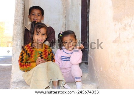 TARIM, YEMEN, DECEMBER 2008: unidentified children who look forward to be photographed by tourists on December 23, 2008 in Tarim. Yemenis are happy when tourists make photos from them. - stock photo