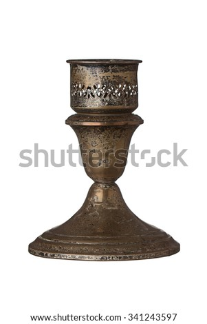 Tarnished antique candlestick holder isolated on a white background. - stock photo
