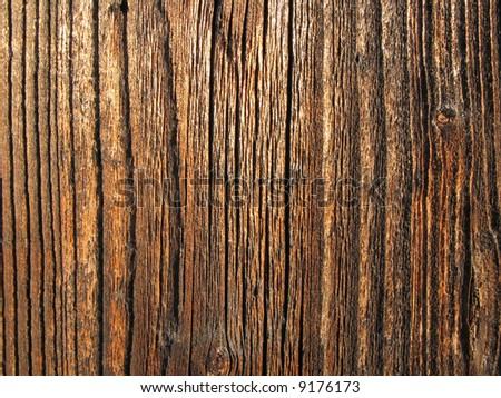 Tarry wooden board texture - stock photo