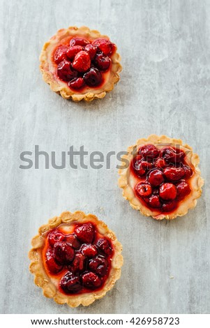 Tart , pie , cake with jellied fresh berries on a grey stone background. Copy space - stock photo