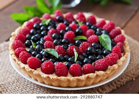 Tart with berries and custard - stock photo