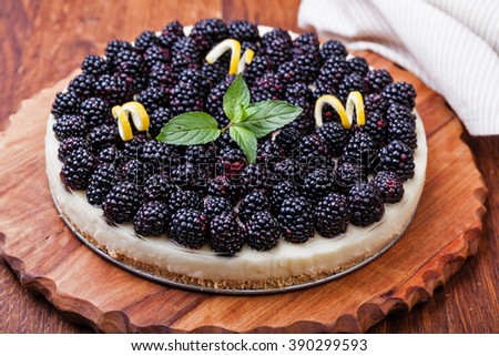 Tart with blackberry and whipped cream - stock photo