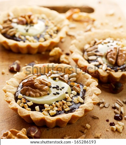 Tart with chocolate and nuts - stock photo