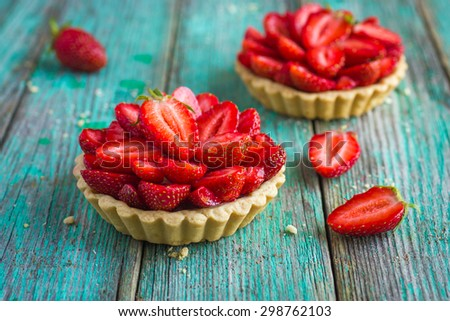 Tart with fresh strawberry on wooden background, - stock photo