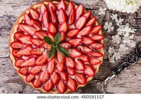 Tart with strawberries and whipped cream - stock photo