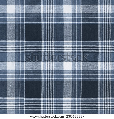 Tartan plaid blue natural cotton fabric. Seamless tiles texture for the background - stock photo