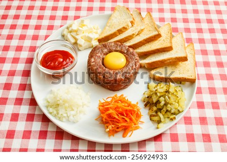 tartare meat with egg yolk - stock photo