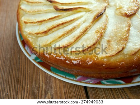 Tarte Normande - variant apple tart made in Normandy filled with apples, sliced almonds and sugar topped with creamy egg custard tart - stock photo