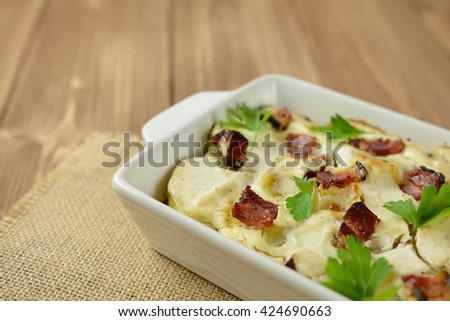 Tartiflette with streaky bacon, potatoes and cheese - stock photo