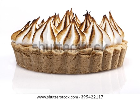 Tartlet Topped with White Flambed Cream Isolated on White Background - stock photo