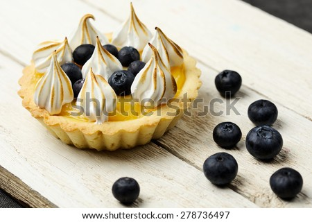 Tartlet with lemon curd, blueberries and meringue horizontal close-up - stock photo
