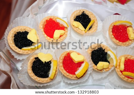Tartlets with caviar and butter - stock photo
