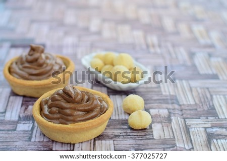 tartlets with chocolate cream and macadamia nuts - stock photo