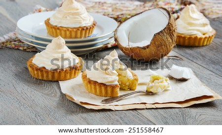 tartlets with coconut cream and meringue - stock photo