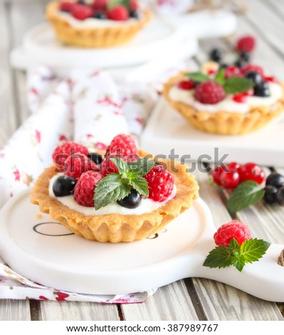 tartlets with creme cheese and fresh berries - stock photo