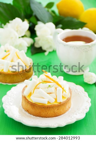 Tartlets with lemon cream and meringue. Lemon pie. - stock photo