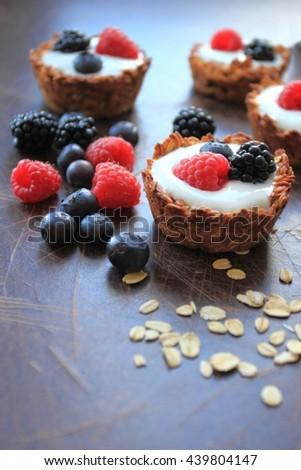 Tarts with oat cereals, yogurt and fresh berries - stock photo