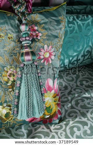 tassel for curtains on a pillow - stock photo