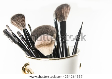 tassels for make up isolated on white background in white make-up cup - stock photo