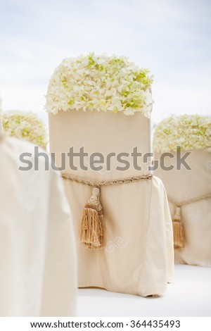 Tassels on a chair, wedding decorations - stock photo