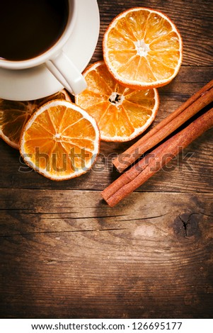 Tastefully presented with a cup of coffee, and orange slices. - stock photo