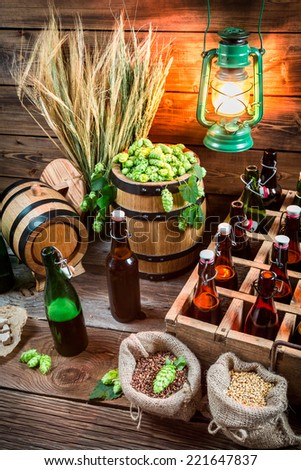 Tasting home-brewed beer in the cellar - stock photo