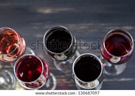 Tasting of wine and pattie chocolate pastries. - stock photo