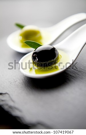 tasting olives and virgin olive oil - stock photo