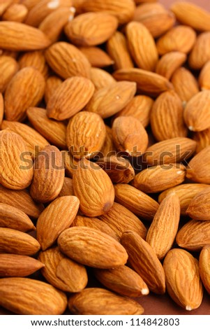 tasty almond nuts, close up - stock photo