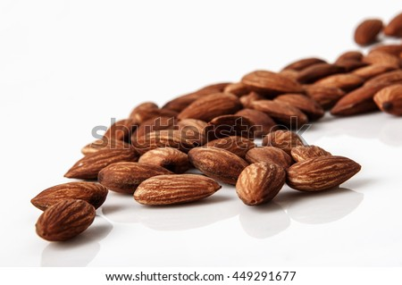 tasty almonds nuts isolated on white background. - stock photo
