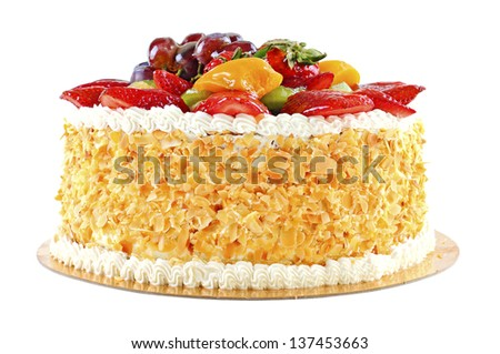 Tasty and beautiful decorated cake with fruits, isolated on white background - stock photo