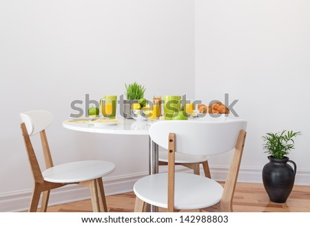 Tasty and healthy breakfast on a white round table. - stock photo