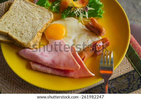 Tasty and high-calorie breakfast in the cafe - stock photo