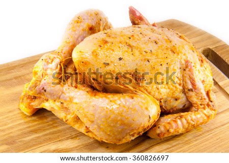 tasty and juicy marinated chicken on a chopping board - stock photo