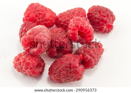tasty and juicy red raspberries isolated on white background - stock photo