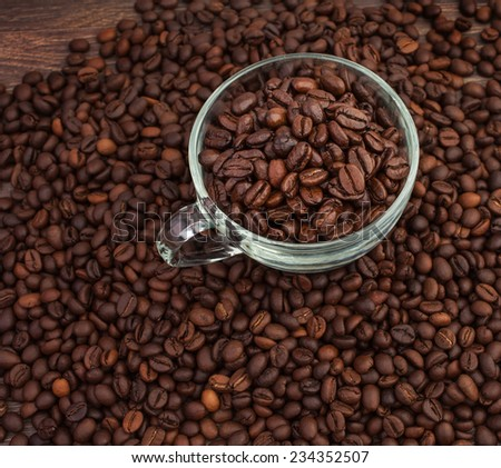 tasty aromatic coffee beans in a glass cup - stock photo