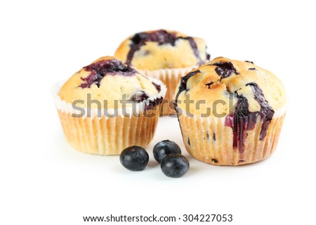 Tasty blueberry muffins isolated on a white - stock photo
