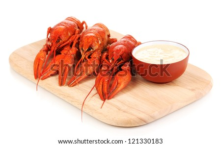 Tasty boiled crayfishes on chopping board isolated on white - stock photo