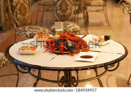 Tasty boiled crayfishes with fennel on table - stock photo