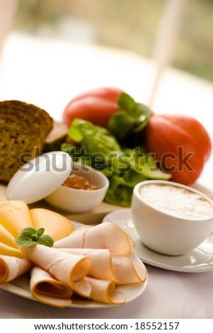 Tasty breakfast / Coffee, bread, cheese, ham, jam - stock photo
