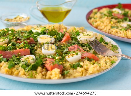 Tasty breakfast dish kedgeree, made with hot smoked salmon, egg, rice, curry powder and parsley. Traditional british dish. - stock photo