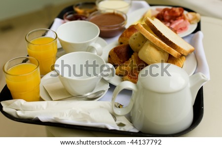 Tasty breakfast for two, closeup of the breakfast tray, focus is on cups - stock photo