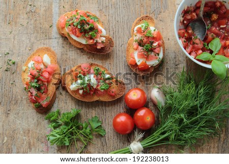 Tasty bruschettas with fresh tomato, garlic, fennel and mozzarella - stock photo
