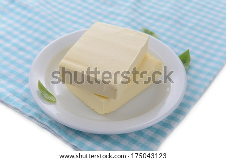 Tasty butter on plate, close up - stock photo