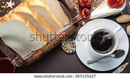 tasty cake closeup with Black Coffee cup - stock photo