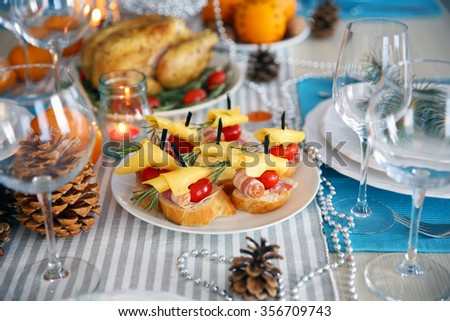Tasty canapes for festive dinner. Thanksgiving day table setting - stock photo