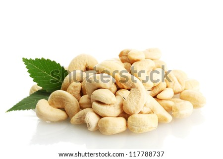 tasty cashew nuts with leaves, isolated on white - stock photo
