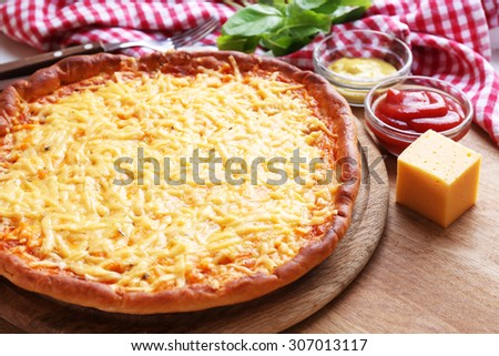 Tasty cheese pizza on table close up - stock photo
