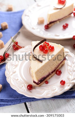 Tasty cheesecake with berries on table close up - stock photo