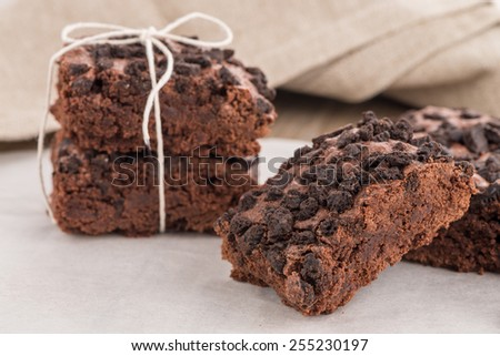 Tasty chocolate brownies on a wooden table. - stock photo
